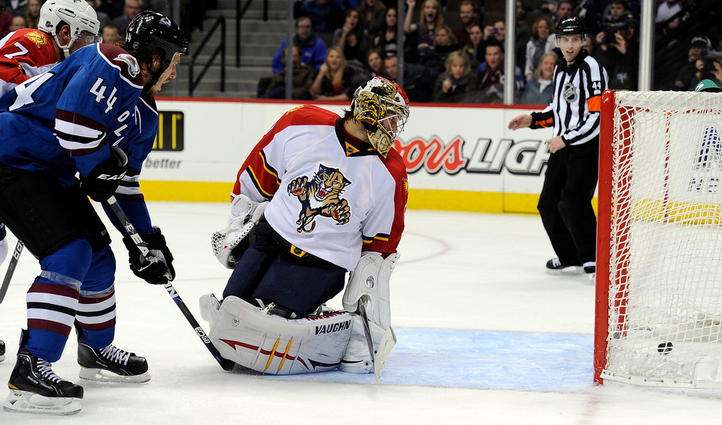 . Florida Panthers goalie Jose Theodore (60) looks back at the puck as its goes in to the goal for a score. Theodore couldn\'t t make the save on a shot by Colorado Avalanche center Ryan O\'Reilly (37) in overtime for the game winner as Colorado Avalanche defenseman Ryan Wilson (44) looks on Wednesday, January 18, 2012 at Pepsi Center.  John Leyba, The Denver Post