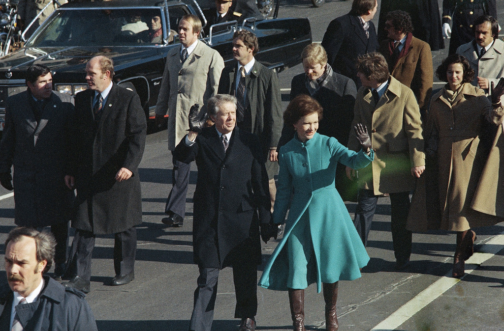 . Jimmy Carter and first lady Rosalynn Carter  walk down Pennsylvania Avenue after Carter was sworn in as the nations 39th President, Jan. 20, 1977, Washington, D.C.  (AP Photo)