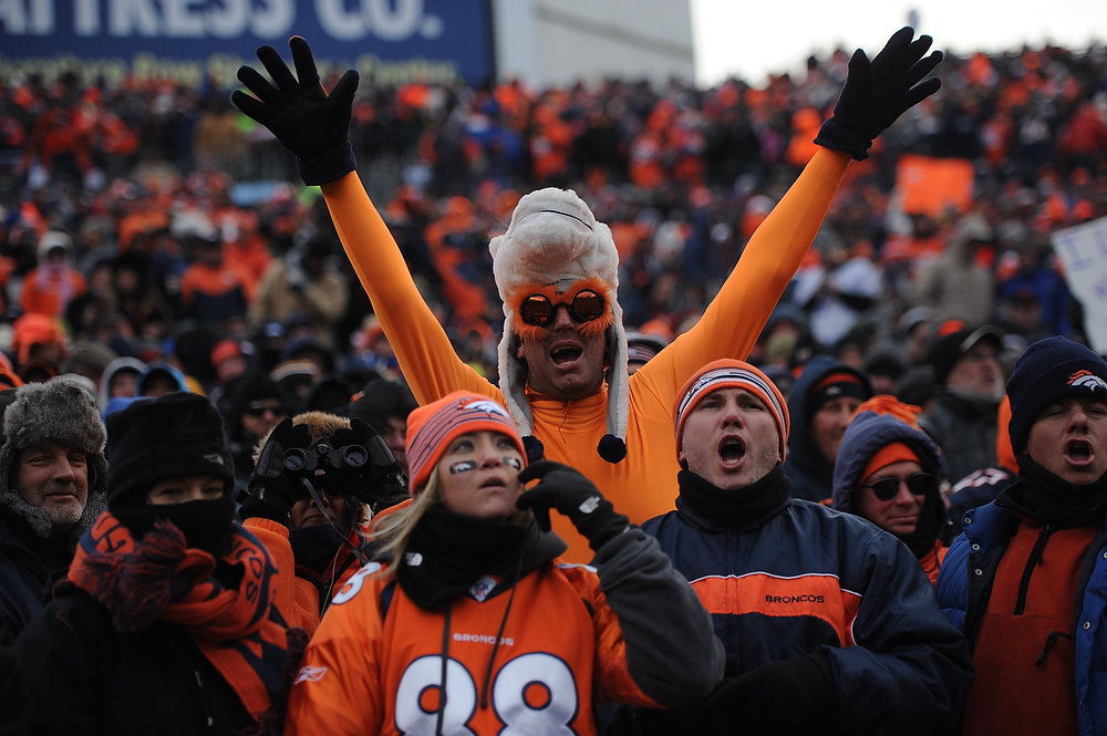 Description of . Fans cheer on the Broncos in the second quarter. The Denver Broncos vs Baltimore Ravens AFC Divisional playoff game at Sports Authority Field Saturday January 12, 2013. (Photo by Joe Amon,/The Denver Post)