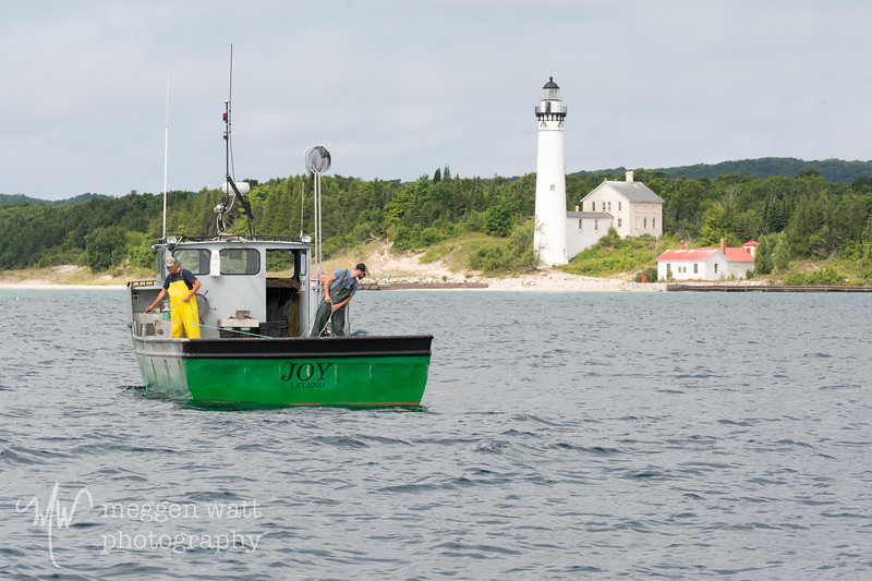 TLR-20180806-4118 Lifting a Net by S Manitou Lighthouse