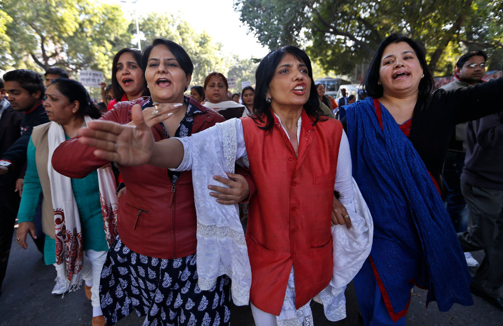 . Women supporters of Bharatiya Janata Party (BJP) shout slogans during a protest over the gang rape of a woman in New Delhi, India, Wednesday, Dec. 19, 2012. Lawmakers, rights groups and citizens across India expressed outrage Wednesday over the gang rape of a woman on a bus in New Delhi and are urging the government to crack down on crimes against women. The outpouring of anger is unusual in a country where attacks against women are often ignored and rarely prosecuted. (AP Photo/ Saurabh Das)
