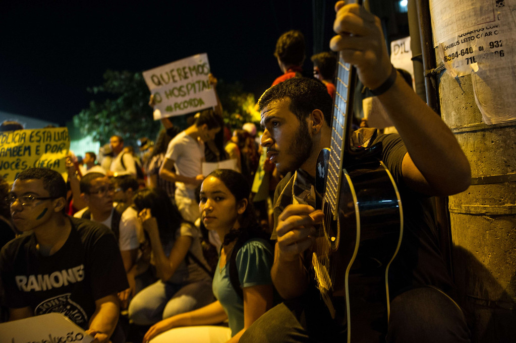 . A man plays a guitar during a demonstration in Belo Horizonte, Brazil, on June 21, 2013. AFP PHOTO / YASUYOSHI  CHIBA/AFP/Getty Images