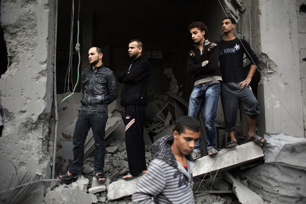 . Palestinians inspect damages at the site of an Israeli air raid in Gaza City on November 17, 2012. Israeli air strikes hit the cabinet headquarters of Gaza\'s Hamas government after militants fired rockets at Jerusalem and Tel Aviv as Israel called up thousands more reservists in readiness for a potential ground war. MARCO LONGARI/AFP/Getty Images