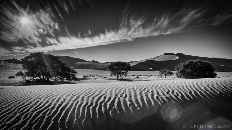 A black & white rendition of the Sossusvlei sand dunes in Namib-Naukluft National Park, Namibia.