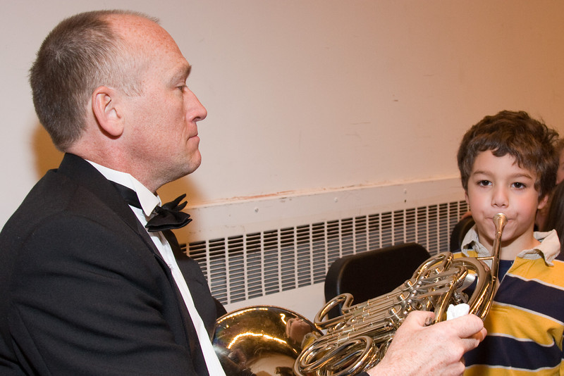 Mark Benson, horn, with child -- Hopkins Symphony Orchestra, March 2008