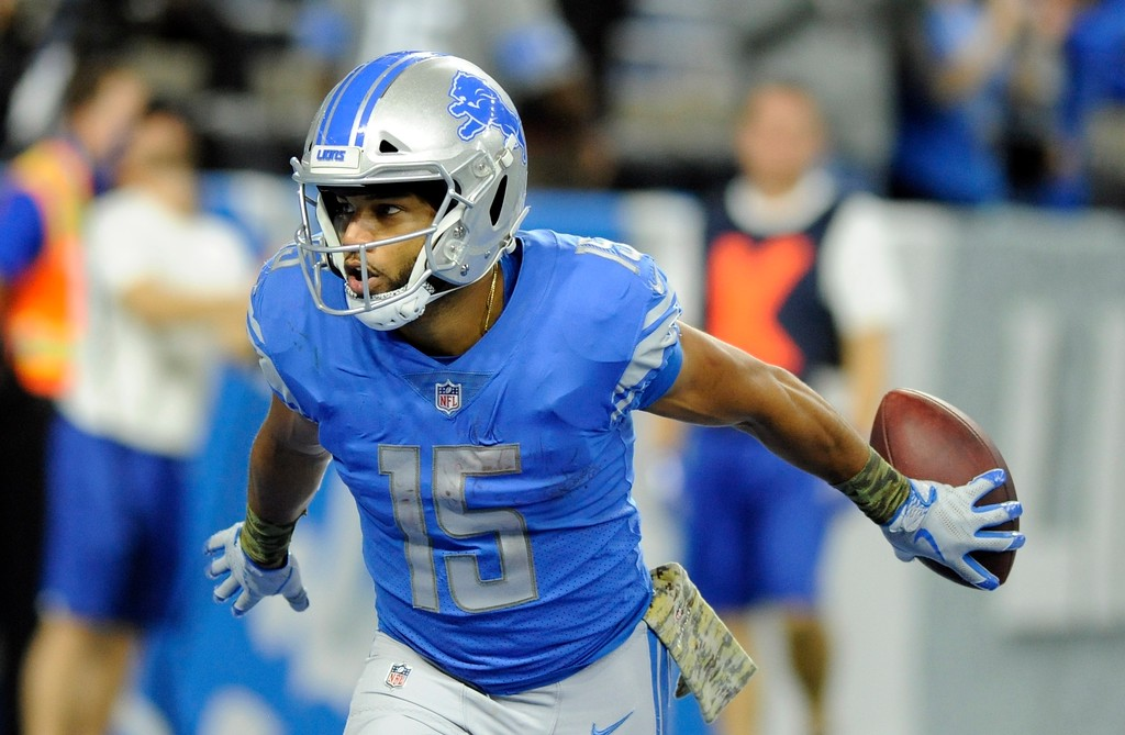 . Detroit Lions wide receiver Golden Tate runs to the bench after rushing for a 40-yard touchdown during the second half of an NFL football game against the Cleveland Browns, Sunday, Nov. 12, 2017, in Detroit. (AP Photo/Jose Juarez)