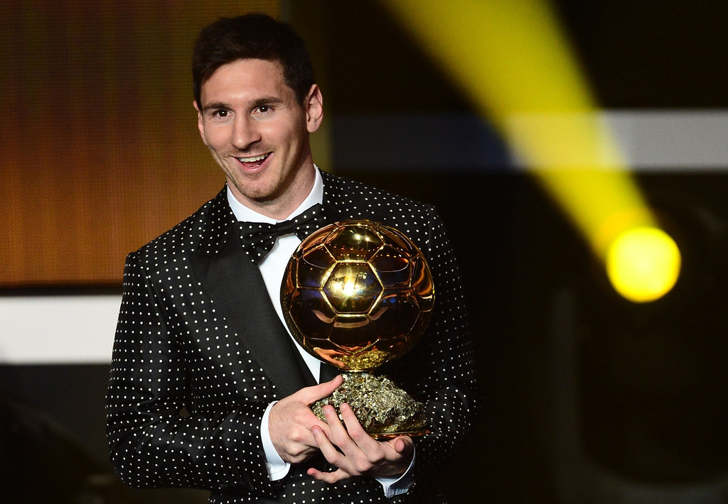 . FIFA Ballon d\'Or award winner Barcelona\'s Argentinian forward Lionel Messi holds the trophy during the FIFA Ballon d\'Or awards ceremony at the Kongresshaus in Zurich on January 7, 2013.   OLIVIER MORIN/AFP/Getty Images