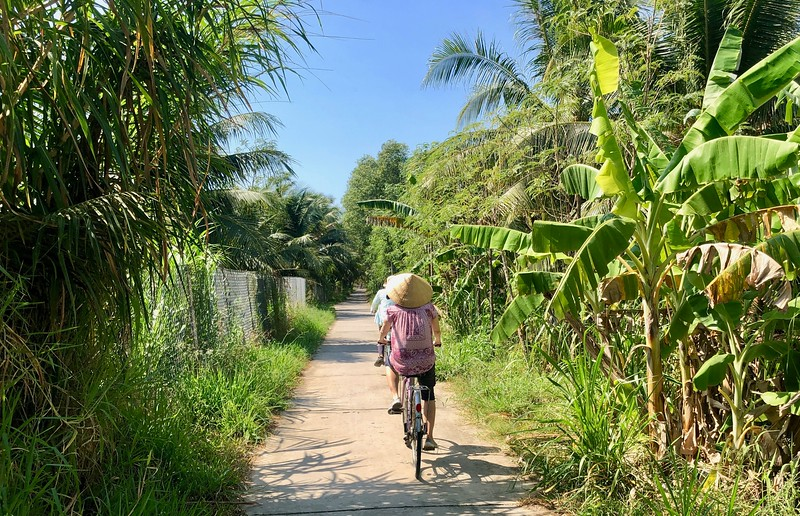 Biking along the pathways of the villages on the delta.