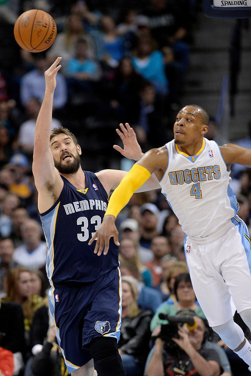 . Memphis Grizzlies center Marc Gasol (33) knocks the ball away from Denver Nuggets guard Randy Foye (4) during the first quarter. (Photo by AAron Ontiveroz/The Denver Post)
