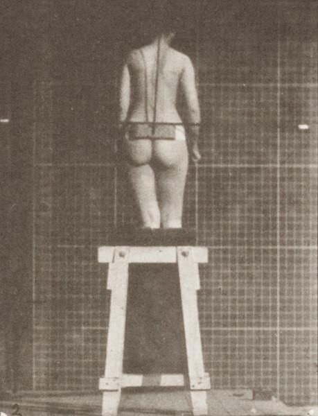 Nude woman descending an incline