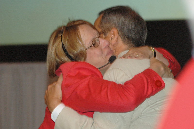 Kathy Bender-Schwick congratulates Carlos Peña after his re-election.