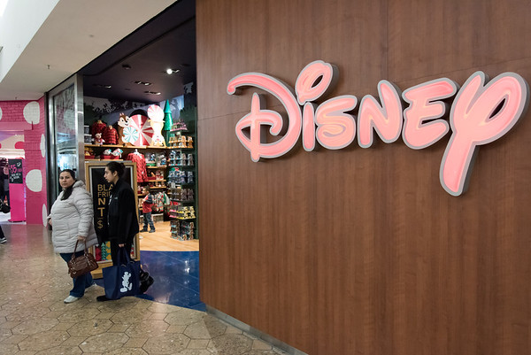 11/23/18 Wesley Bunnell | Staff Shoppers exit the Disney Store on Black Friday at the Westfarms Mall.