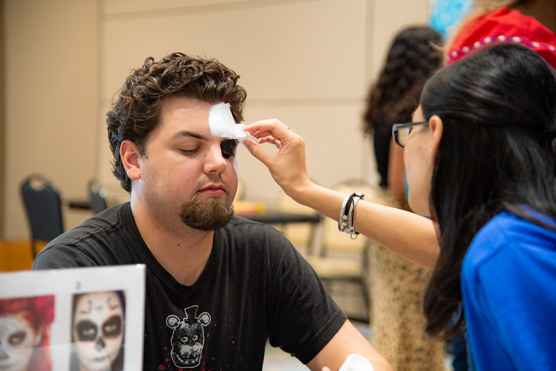 Flynn Long gets his face painted at the Las Muralistas Community Painting Event in the University Center.