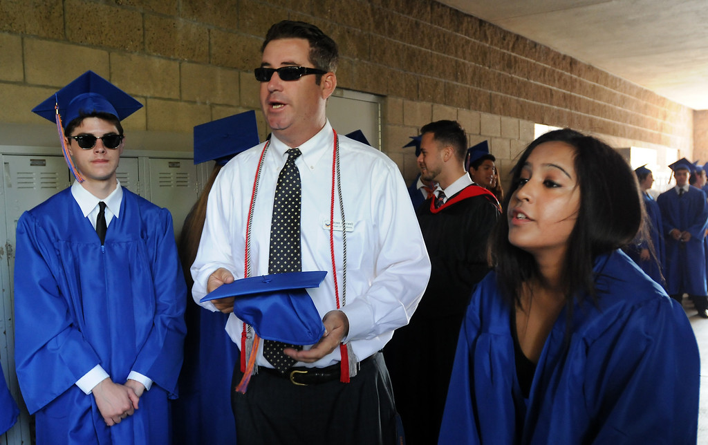 . Dean of Students, Bryan Cantwell, helps organize students before entering the graduation ceremony.  Chaminade College Preparatory High School, celebrating its 60th anniversary, graduated 337 students at the West Hills campus on Saturday, June 01, 2013.  (Dean Musgrove/Los Angeles Daily News)
