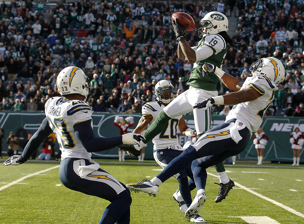 . Clyde Gates #19 of the New York Jets elevates over Brandon Taylor #28 of the San Diego Chargers to make a catch during their game at MetLife Stadium on December 23, 2012 in East Rutherford, New Jersey. (Photo by Jeff Zelevansky/Getty Images)