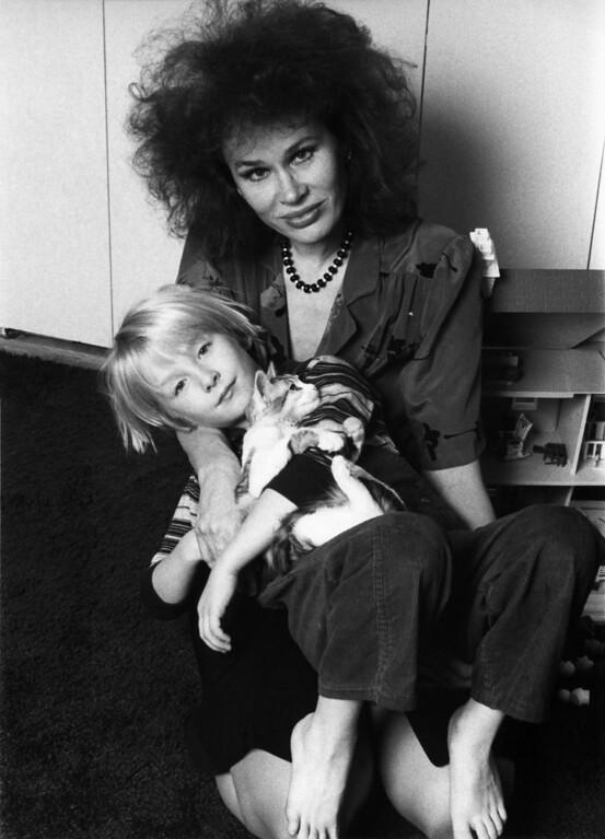 . US actress Karen Black holds her son Hunter in their apartment in New York\'s Greenwich Village, United States in 1982. (AP Photo/W. Abbott)