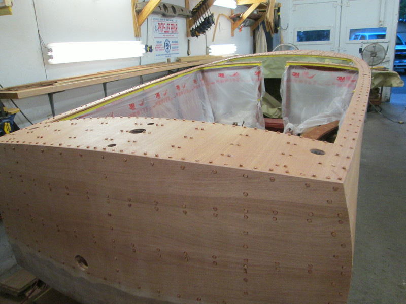 Rear starboard view of the deck and transom sanded, drilled and plugged.