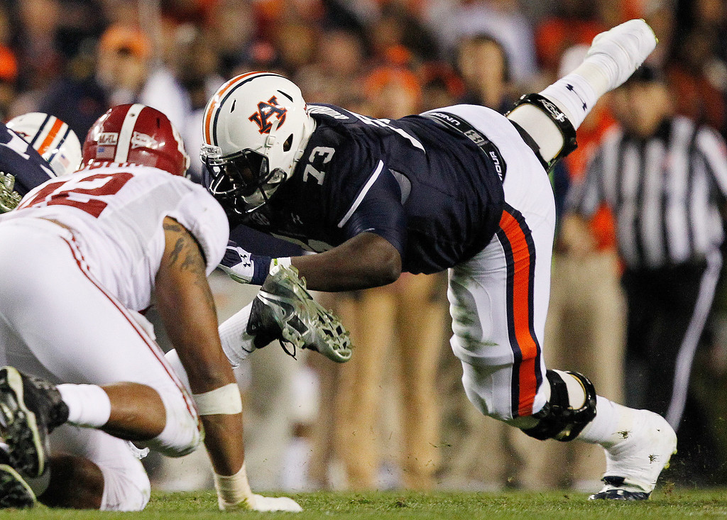 . In this Nov. 30, 2013, photo, Auburn offensive linesman Greg Robinson (73) blocks during the second half of an NCAA college football game against Alabama in Auburn, Ala. Robinson was chosen by the St. Louis Rams as the second pick in the first round of the 2014 NFL Draft. (AP Photo/Butch Dill, File)