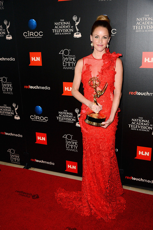 . Actress Julie Marie Berman poses with the Outstanding Supporting Actress In A Drama Series award for \'General Hospital\' in the press room during The 40th Annual Daytime Emmy Awards at The Beverly Hilton Hotel on June 16, 2013 in Beverly Hills, California.  (Photo by Mark Davis/Getty Images)