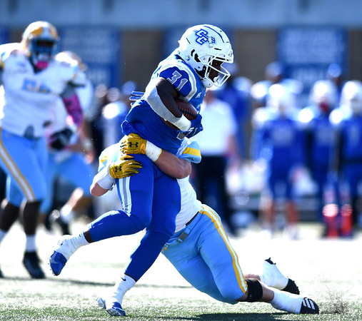 10/26/2019 Mike Orazzi | Staff CCSU's Enyce Walker (31) and Long Island University's Dylan Cook (4) during Saturday's football game in New Britain.
