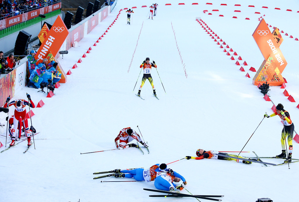. Eric Frenzel (2ndR) of Germany collapses with fellow competitors as he wins the gold medal during the Nordic Combined Individual Gundersen Normal Hill and 10km Cross Country on day 5 of the Sochi 2014 Winter Olympics at the RusSki Gorki Nordic Combined Skiing Stadium on February 12, 2014 in Sochi, Russia.  (Photo by Al Bello/Getty Images)