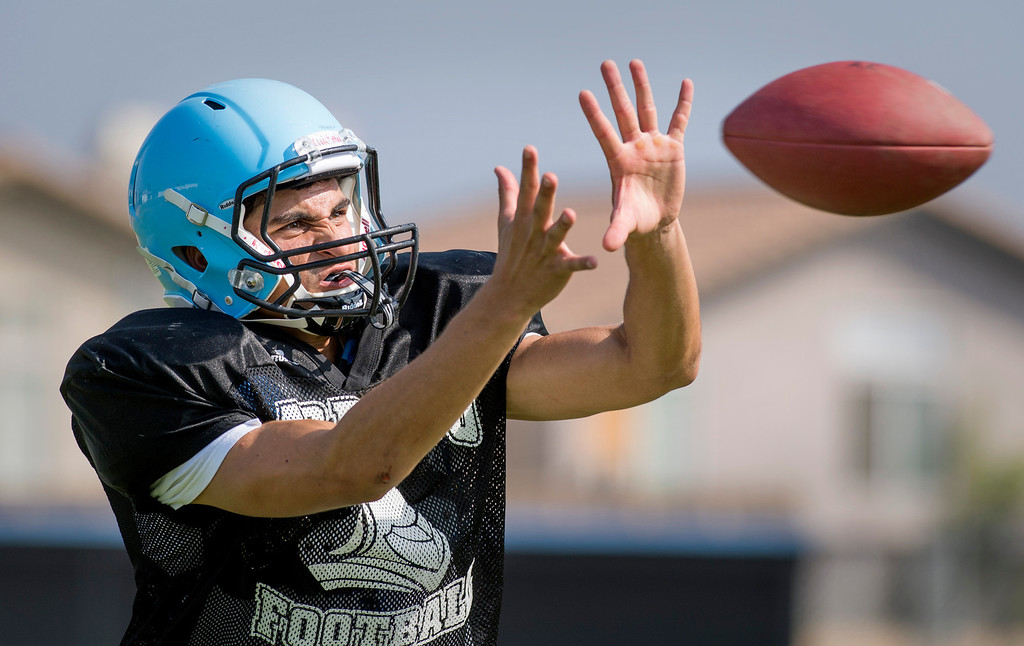 . Arroyo High WR David Cotero hauls in a pass during preseason practice at the El Monte campus August 14, 2013.   (SGVN/Staff photo by Leo Jarzomb)