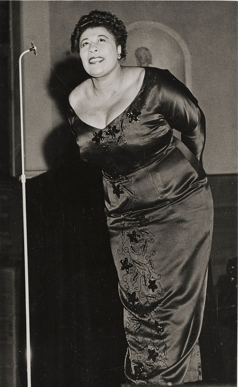 ". Ella Jane Fitzgerald (April 25, 1917 � June 15, 1996), also known as the ""First Lady of Song\"", \""Queen of Jazz\"", and \""Lady Ella\"", was an American jazz and song vocalist. Fitzgerald was a notable interpreter of the Great American Songbook. Over the course of her 59-year recording career, she was the winner of 13 Grammy Awards and was awarded the National Medal of Arts by Ronald Reagan and the Presidential Medal of Freedom by George H. W. Bush. Here Ella Fitzgerald performs at a concert in Stockholm, Sweden, Feb. 10, 1952.  (AP Photo)"