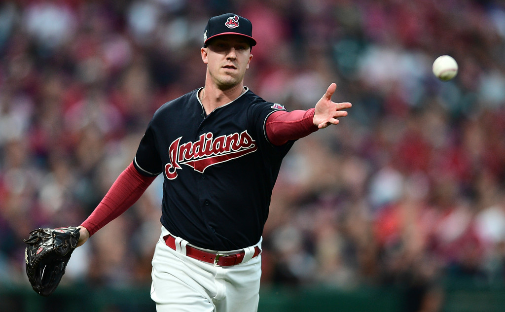 . Cleveland Indians relief pitcher Tyler Olson tosses the ball to first base to get New York Yankees\' Brett Gardner out in the fourth inning of Game 2 of baseball\'s American League Division Series, Friday, Oct. 6, 2017, in Cleveland. (AP Photo/David Dermer)