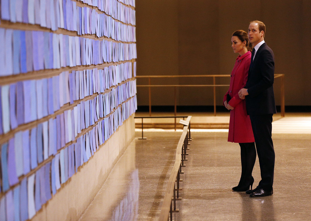 . Prince William, Duke of Cambridge and Catherine, Duchess of Cambridge gaze at a commemorative installation during a visit the National September 11 Memorial & Museum on December 09, 2014 in New York City.  The couple, who are traveling without their son Prince George, are on a three-day US east coast visit. This is the Duke and Duchess\' first official visit to New York City. (Photo by Jonathan Brady - Pool/Getty Images)