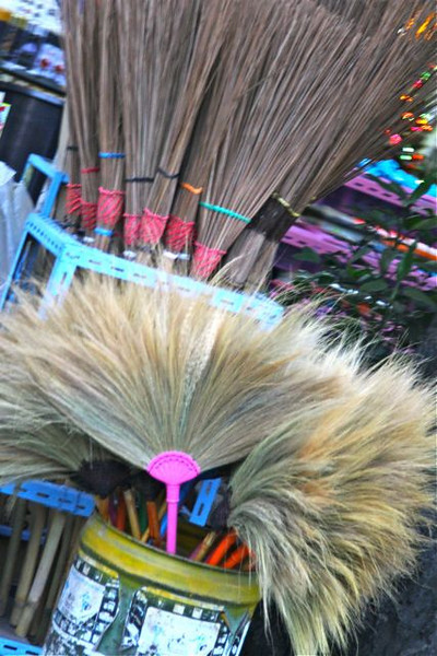Broom and household wares at a streetside vendor