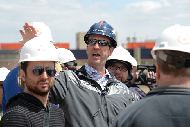 . Denver Broncos Vice President of Operations Chip Conway explains about the facility build-indoor practice field during the media tour at the construction site in Centennial, Colorado,  April 30,  2014. (Photo by Hyoung Chang/The Denver Post)