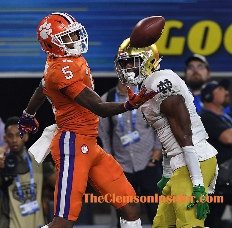 Clemson wide receiver Tee Higgins (5) pulls in a 19 yard TD past Notre Dame cornerback Donte Vaughn (8) with 2 seconds left to play in the 2nd quarter of the Goodyear Cotton Bowl at AT&T stadium in Arlington, TX Saturday, December 29, 2018.