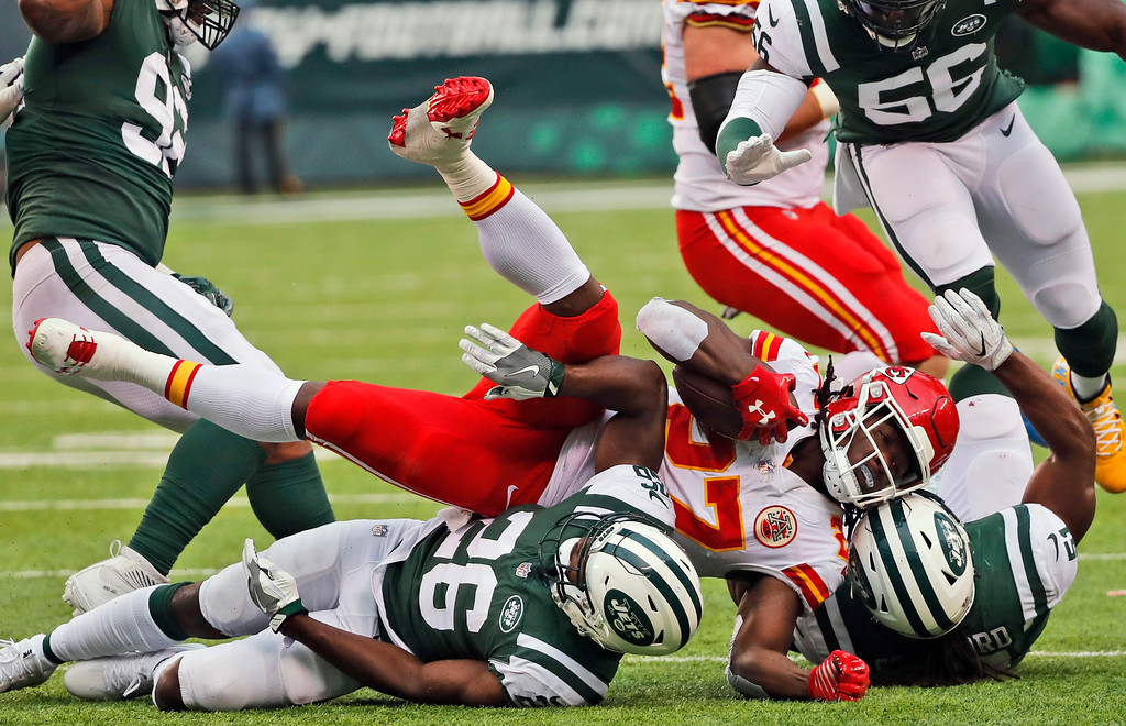 . Kansas City Chiefs\' Kareem Hunt (27), center, is brought down by New York Jets defenders during the second half of an NFL football game, Sunday, Dec. 3, 2017, in East Rutherford, N.J. (AP Photo/Julie Jacobson)