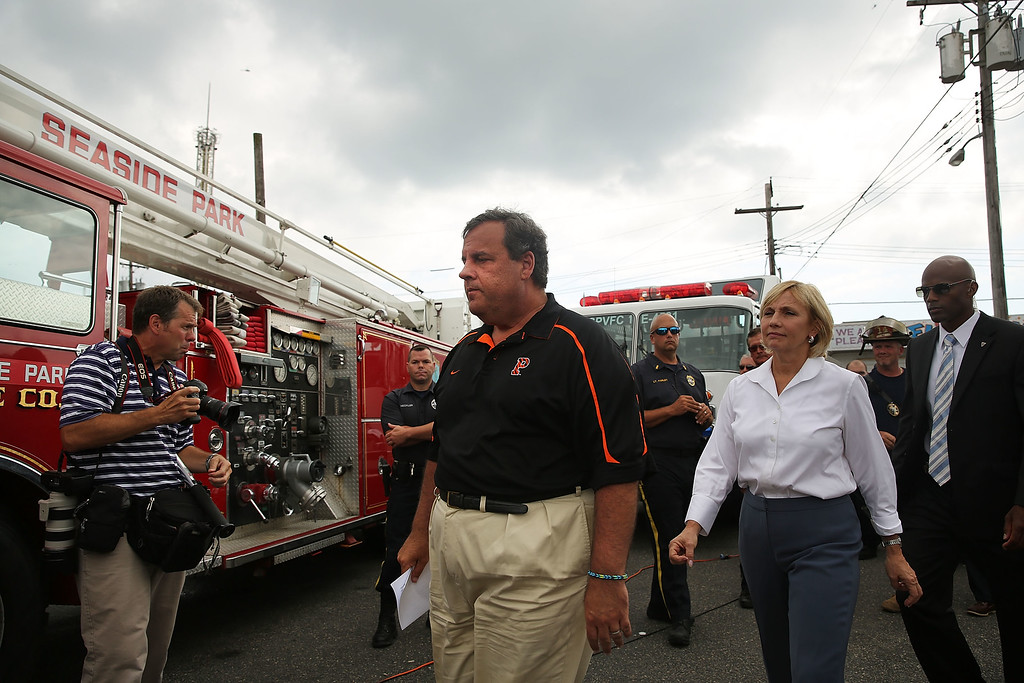 . New Jersey Gov. Chris Christie walks away after speaking to the media at the scene of a massive fire that destroyed dozens of businesses along an iconic Jersey shore boardwalk on September 13, 2013 in Seaside Heights, New Jersey.  (Photo by Spencer Platt/Getty Images)