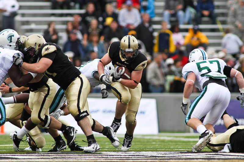 "Run to daylight- the preferred method of offense used by the Green Bay Packers during their glory days of the 60's.   ""As coach of the Packers, Lombardi converted Notre Dame quarterback and Heisman Trophy winner Paul Hornung to a full-time halfback. Lombardi designed a play for Hornung based on an old single wing concept—both guards pulled to the outside and blocked downfield while Hornung would ""run to daylight"" -- i.e., wherever the defenders weren't. This was a play that he had originally developed with the Giants for Gifford that would become famous as the ""Lombardi sweep"" or ""Packer power sweep."" "" -Wikipedia"