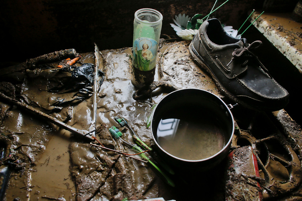 . Part of the belongings of Enrique Cota Cece�a sit covered in mud inside his house which was severely flooded by Hurricane Odile in Los Cabos, Mexico, Monday, Sept. 15, 2014.  (AP Photo/Victor R. Caivano)