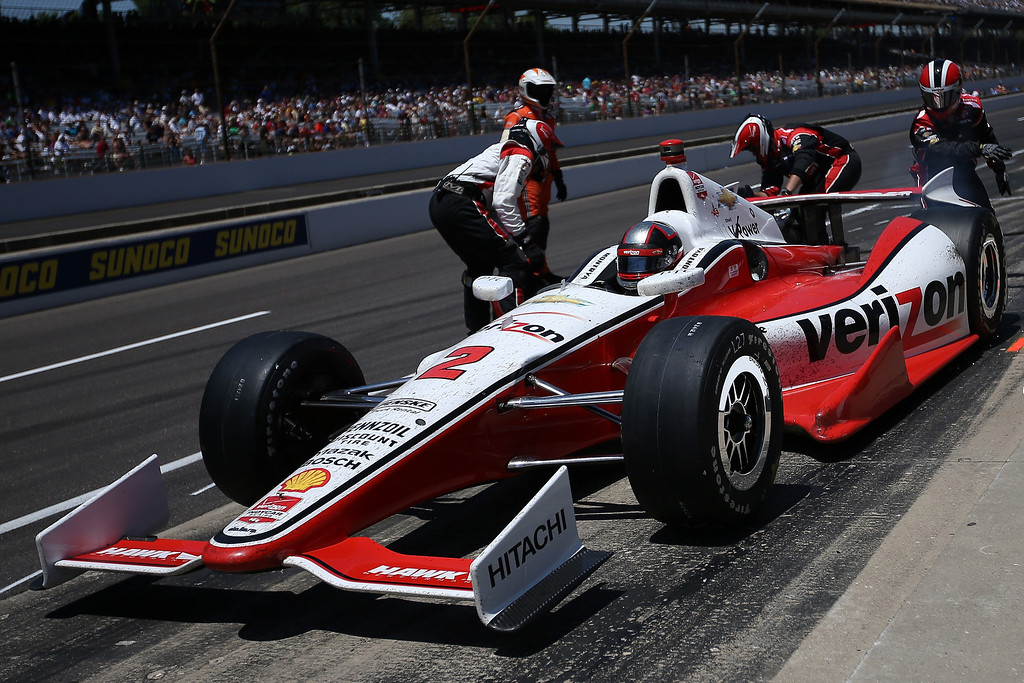 . Juan Pablo Montoya of Columbia, driver of the #2 Verizon Team Penske Chevrolet Dallara, comes in for a pit stop during the 98th running of the Indianapolis 500 Mile Race at Indianapolis Motorspeedway on May 25, 2014 in Indianapolis, Indiana.  (Photo by Chris Graythen/Getty Images)