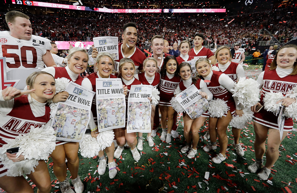 . Alabama cheerleaders celebrate after overtime of the NCAA college football playoff championship game against Georgia Monday, Jan. 8, 2018, in Atlanta. Alabama won 26-23. (AP Photo/David J. Phillip)