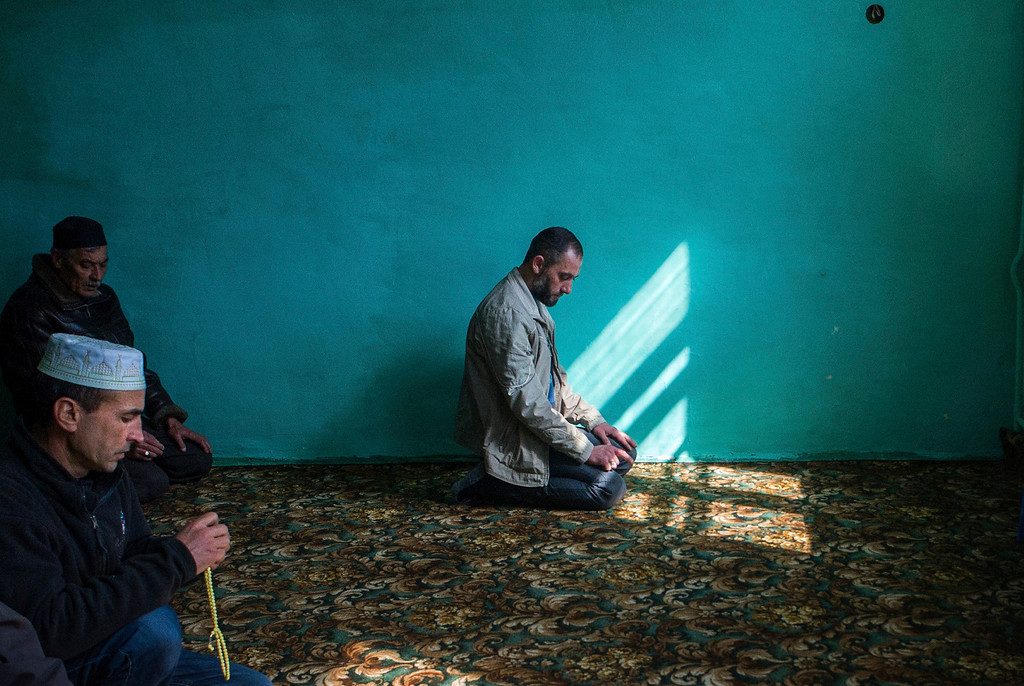 . Crimean Tatars pray during a Friday prayers in a mosque in the village of Orlinoye near Sevastopol, Crimea, Ukraine, Friday, March 14, 2014. Crimea plans to hold a referendum on Sunday that will ask residents if they want the territory to become part of Russia. Ukraine\'s government and Western nations have denounced the referendum as illegitimate and warned Russia against trying to annex Crimea. (AP Photo/Andrew Lubimov)