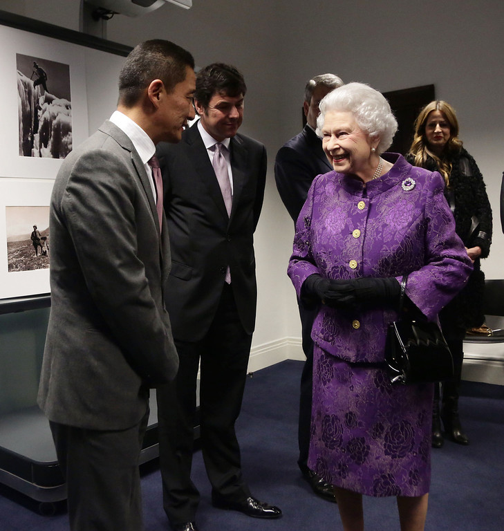 . Queen Elizabeth II meeting Nepalese Sherpa mountain climber Jamling Norgay, left, son of Tenzing Norgay, during a reception to celebrate the 60th Anniversary of the ascent of Everest, at the Royal Geographical Society in Kensington, west London, Wednesday May 29, 2013. (AP Photo/Yui Mok, Pool)