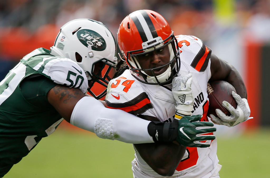 . Cleveland Browns running back Isaiah Crowell (34) runs against New York Jets linebacker Freddie Bishop (50) during the first half of an NFL football game, Sunday, Oct. 8, 2017, in Cleveland. (AP Photo/Ron Schwane)