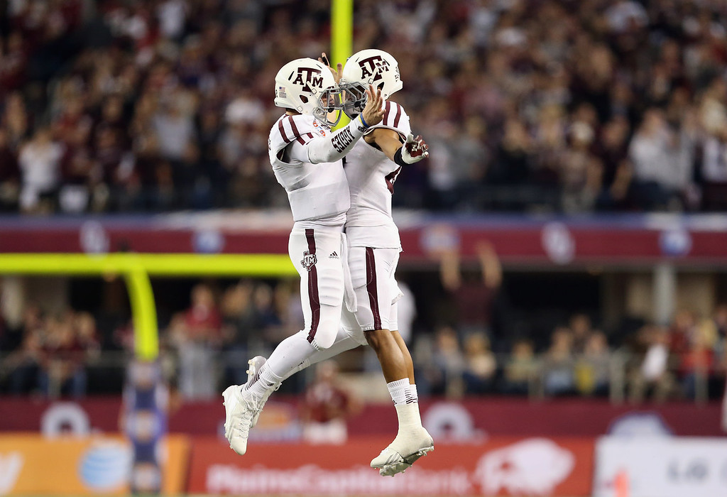 . (L-R) Johnny Manziel #2 of the Texas A&M Aggies celebrates a touchdown with Dustin Harris #22 against the Oklahoma Sooners during the Cotton Bowl at Cowboys Stadium on January 4, 2013 in Arlington, Texas.  (Photo by Ronald Martinez/Getty Images)