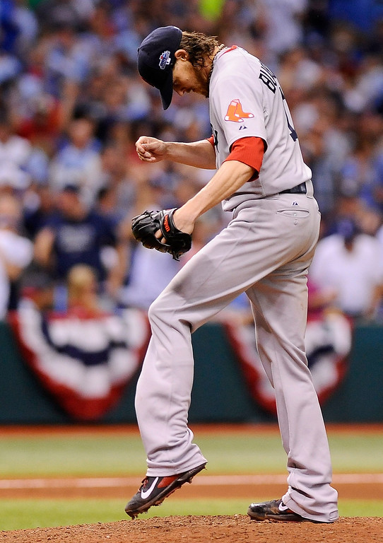 . Clay Buchholz #11 of the Boston Red Sox reacts after allowing a three-run home run to Evan Longoria #2 of the Tampa Bay Rays in the fifth inning during Game Three of the American League Division Series at Tropicana Field on October 7, 2013 in St Petersburg, Florida.  (Photo by Brian Blanco/Getty Images)