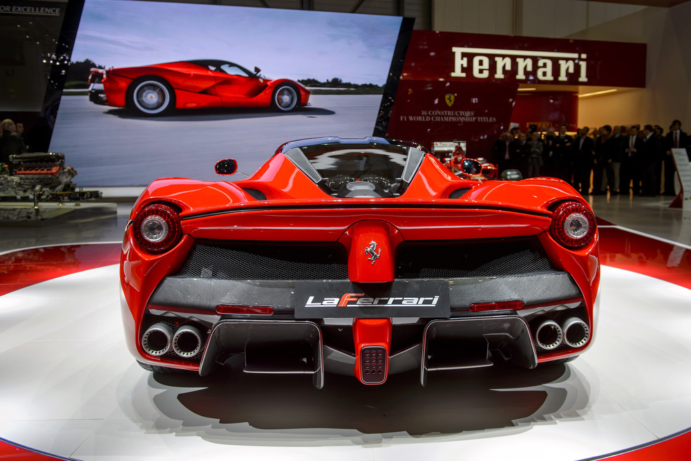 . The new La Ferrari hybrid model car is displayed as World premiere at the Italian car maker\'s booth during the 83rd Geneva Motor Show on March 5, 2013. The Geneva International Motor Show opened its doors under a dark cloud, with no sign of a speedy rebound in sight for the troubled European market.  FABRICE COFFRINI/AFP/Getty Images