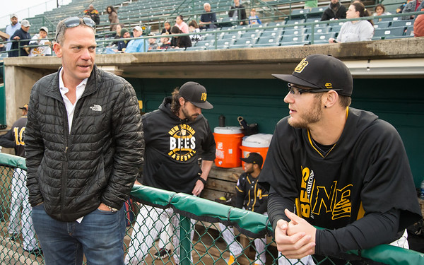 05/03/19 Wesley Bunnell | Staff The New Britain Bees home opener vs the Somerset Patriots on Friday night at New Britain Stadium. Bees partner Anthony Iacovone, L, speaks with Brandon Fry (20) before the start of the game.