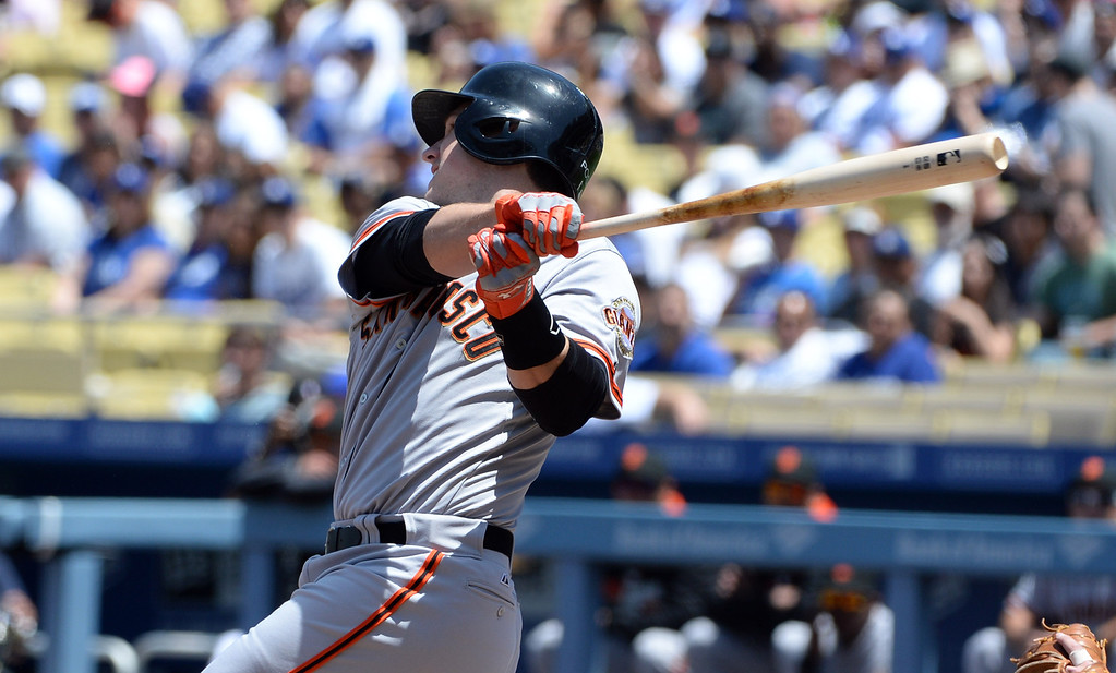 . San Francisco Giants\' Buster Posey watches his single against the Los Angeles Dodgers in the first inning of a Major league baseball game on Saturday, May 10, 2013 in Los Angeles.   (Keith Birmingham/Pasadena Star-News)