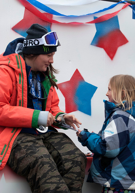 """. Kayla Rice/Reformer                                 Elaina Krusiewski, 8, of Dover gets an autograph from Mount Snow athlete and Olympic silver medalist Devin Logan before the \""""Devin Day\"""" parade and celebration in Dover on Saturday."""