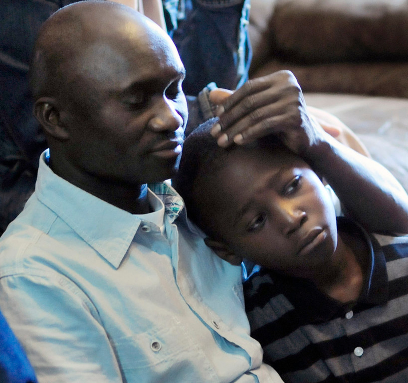 . Lancine Fofana, the father of 10-year-old Zack Mohamed Fofana, consoles his younger son, Al-Seny Fofana, 8, while speaking about Zack at the family\'s home in Minneapols on Thursday. Zack was killed in a landslide while on a field trip to Lilydale Regional Park with his class from  Peter Hobart Elementary School in St. Louis Park.   (Pioneer Press: Scott Takushi)