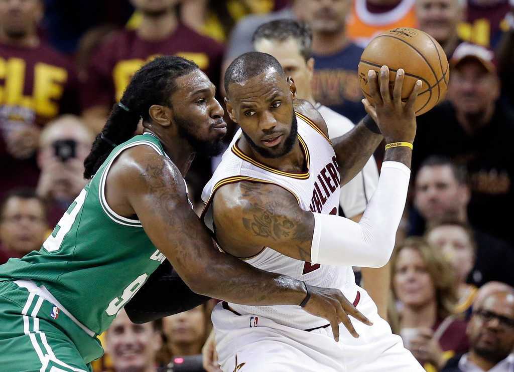 . Cleveland Cavaliers\' LeBron James, right, backs down Boston Celtics\' Jae Crowder (99) during the first half of Game 3 of the NBA basketball Eastern Conference finals, Sunday, May 21, 2017, in Cleveland. (AP Photo/Tony Dejak)