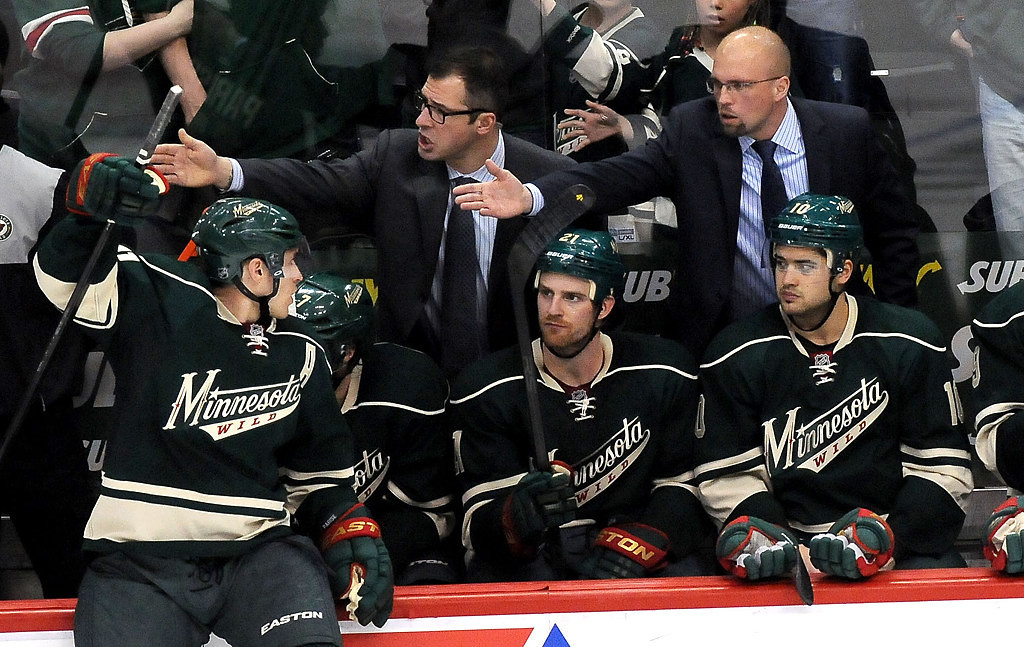 . Minnesota Wild assistant coach Darryl Sydor, top middle, and head coach Mike Yeo, top right, during a bit of confusion on the first skater of the shootout. Zach Parise, left, watches and takes the ice for the shootout. (Pioneer Press: Sherri LaRose-Chiglo)